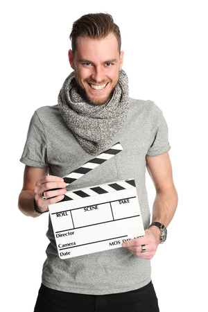 cinematographer: A young attractive man wearing a grey shirt and scarf. Standing holding a movie slate against a white background.