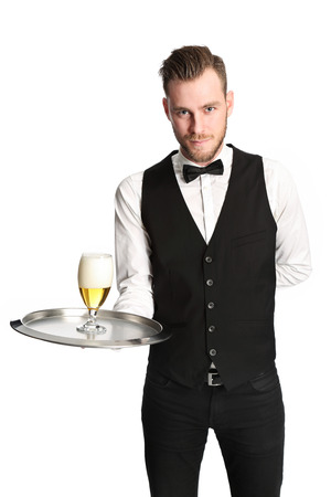 waiter serving: Young attractive waiter wearing a white shirt and black vest, serving a nice cold beer. White background.