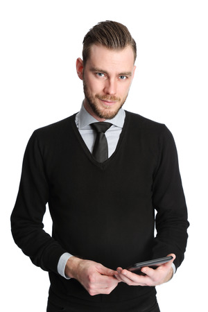professional portrait: An attractive businessman wearing a shirt and tie, working on a digital tablet. White background.