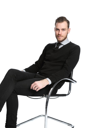 well laid: A young and attractive businessman, wearing a shirt and tie sitting down. White background.