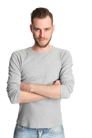 Attractive man standing with a white white background wearing a grey shirt, feeling great!