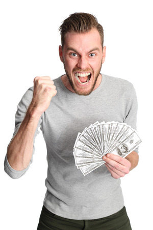 Attractive man wearing a shirt, holding a fan of dollar bills in front of him. White background. Stock Photo