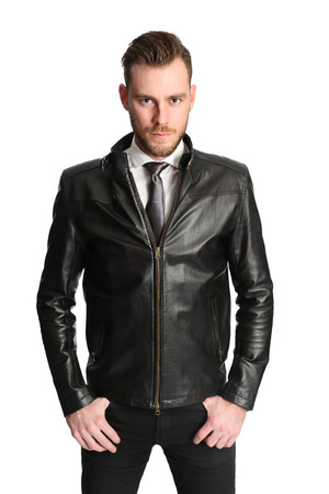 Attractive man wearing a white shirt black tie and a black leather jacket. White background.