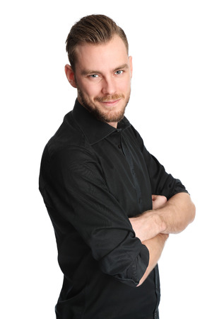An attractive man standing in a studio with white background, wearing a black shirt. Feeling great!