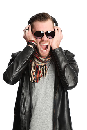Attractive DJ wearing a black leather jacket and sunglasses. White background.