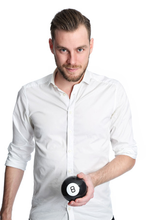 good shirt: A good looking young man in his 20s wearing a white shirt holding an 8ball forecasting his future. White background.