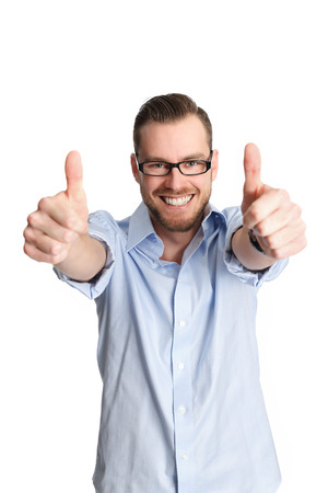 Very happy man wearing a shirt and glasses doing two thumbs up. Standing with a white background.