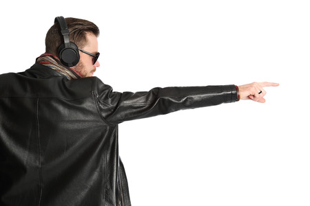 view from behind: Attractive DJ wearing a black leather jacket and sunglasses with his arms raised, view from behind. White background.
