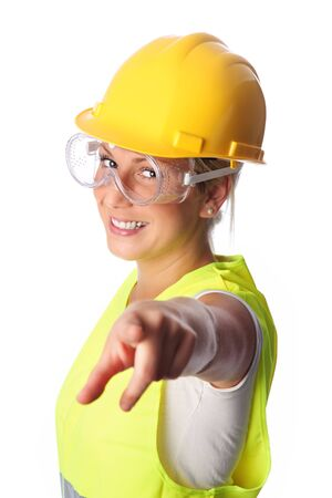 reflective vest: Young attractive female construction worker wearing a reflective vest and hard hat. White background.
