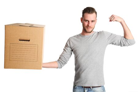 carboard box: An attractive man lifting a carboard box and flexing his muscle, wearing a grey shirt with jeans. White background.