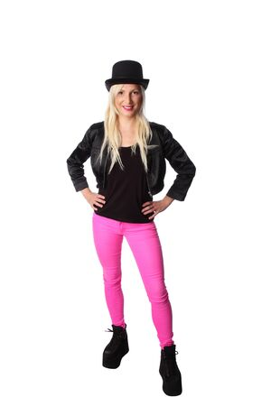 tophat: Attractive blonde woman in her 20s wearing a black jacket, pink pants and a top hat. White background.