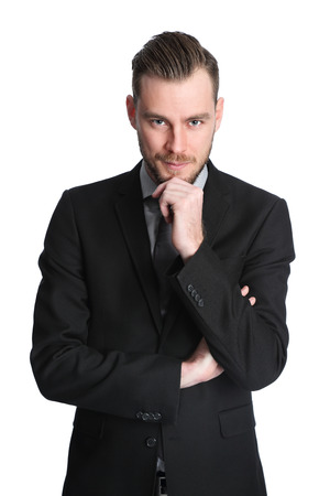 well made: Attractive businessman in his 20s wearing a black suit with an black tie. White background.