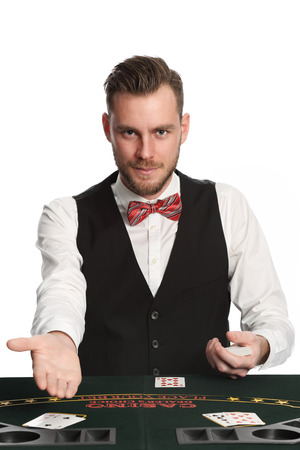 lucky man: Attractive black jack dealer in his 20s with a beard, wearing a white shirt, black vest and a red bowtie, pointing at you. White background.