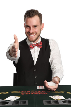 black jack: Attractive black jack dealer in his 20s with a beard, wearing a white shirt, black vest and a red bowtie, pointing at you. White background.