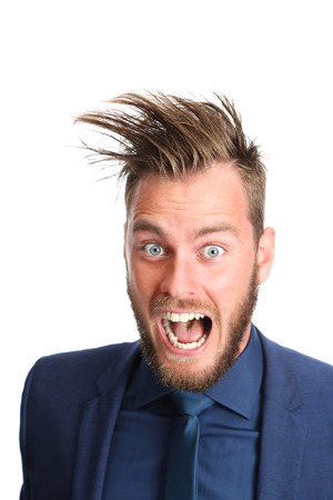 Crazy businessman with big hair screaming. Wearing a blue suit and blue tie. White background.