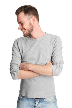 20's: An attractive man in his 20s wearing a grey sweater standing against a white background.