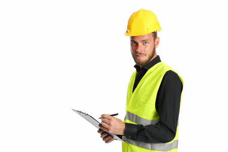 worker working: Attractive construction foreman in his 20s, wearing a yellow safety helmet with a yellow vest, holding a clipboard. White background.