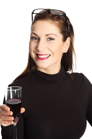 tight focus: Woman in her 20s standing wearing a black sweater with glasses on her head, holding a wine glass smiling towards camera. White background. Stock Photo