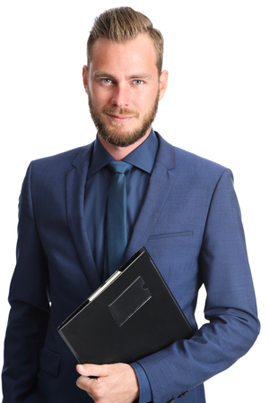 business suit: Attractive businessperson standing in a blue suit and tie holding a clipboard. White background.