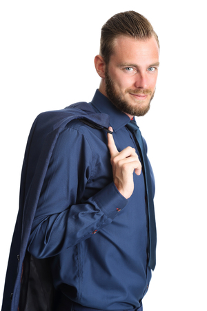 well laid: A relaxed businessman standing against a white background, holding his blazer. Looking at camera.