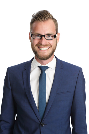 white suit: A handsome businessman in his 20s standing in front of a white background, wearing a blue suit and tie with glasses. Feeling confident and successful. Stock Photo