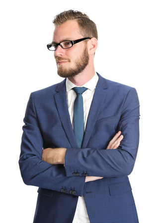 well laid: A handsome businessman in his 20s standing in front of a white background, wearing a blue suit and tie with glasses. Feeling confident and successful. Stock Photo