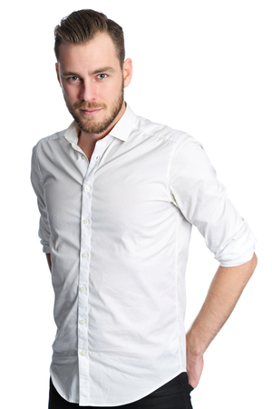 well laid: A man in his 20s wearing a white shirt and black jeans, standing with his hands in pocket in a studio. White background.