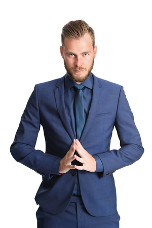 pleading: An attractive businessman praying for a great year. Wearing a blue suit with a blue shirt. White background.