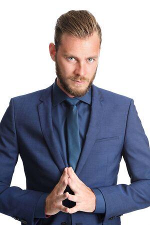Een aantrekkelijke zakenman bidden voor een geweldig jaar. Het dragen van een blauw pak met een blauw shirt. Witte achtergrond.