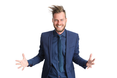 wtf: Crazy businessman in a blue suit with crazy hair. Screaming against camera. White background.