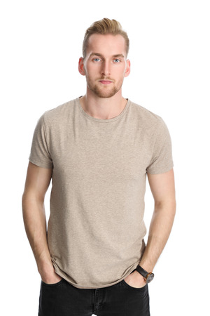 well laid: An attractive healthy man standing against a white background wearing a beige t-shirt.