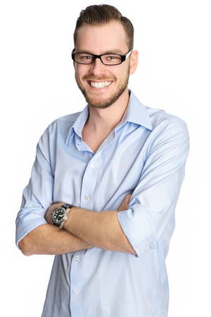 rolled up sleeves: A handsome man in his 20s, wearing a blue shirt and glasses smiling. White background. Stock Photo
