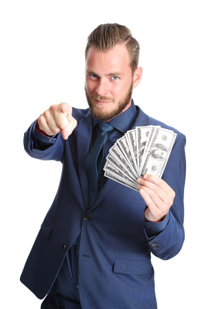 mature business man: Attractive businessman wearing a blue suit and tie, holding a big fan of 100 dollar bills, with a big smile on his face. White background.