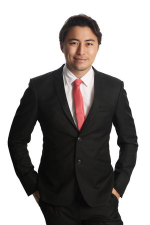 red tie: Smiling businessman in a black suit with a red tie.