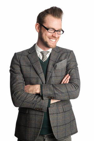 well laid: Attractive businessman wearing a grey checkered jacket, tie and green pullover smiling looking away from camera, standing against a white background.