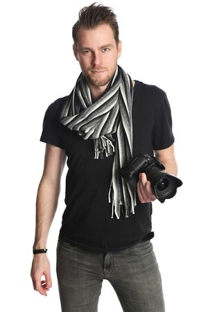 freelancing: Attractive photographer with a digital slr camera, wearing a black tshirt, scarf and jeans. Standing against a white background.