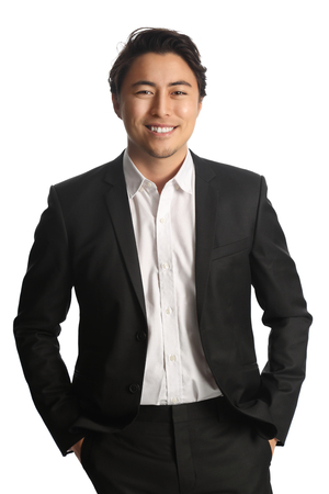 well laid: Trendy businessman wearing a black suit and white shirt smiling, looking at camera. White background. Stock Photo