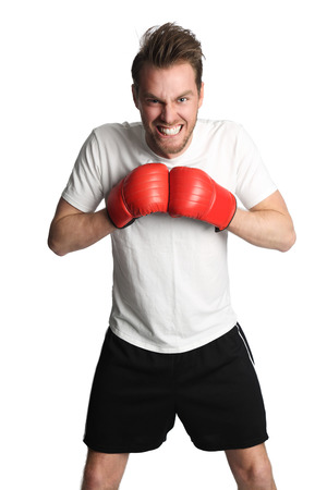 punched out: Attractive man wearing a white tshirt and black shorts with red boxing gloves, punching. White background.