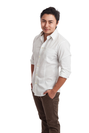 khaki pants: Handsome man standing with hand in pocket wearing a white shirt and khaki pants. White background. Stock Photo