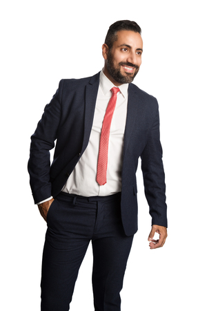 busines: An attractive businessman in his 40s wearing a blue suit with a red tie, standing against a white background with a smile on his face.