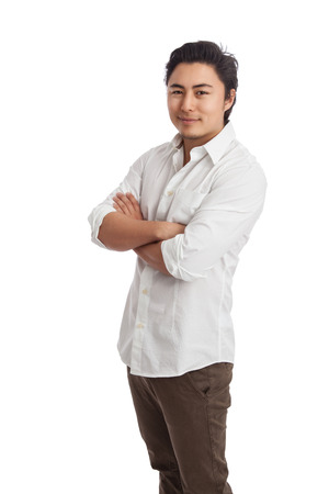 well laid: Handsome man standing with arms crossed wearing a white shirt and khaki pants. White background. Stock Photo