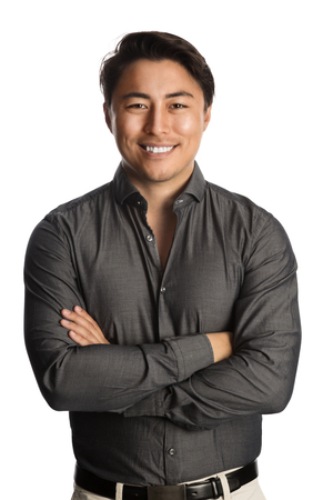 well laid: A trendy good looking man wearing a grey shirt standing against a white background relaxing.