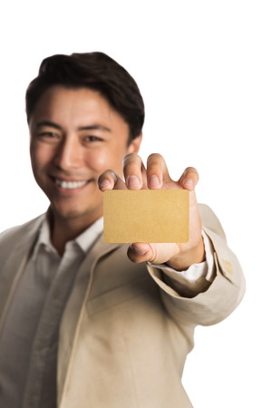 well laid: Attractive man in a bright beige suit, holding a golden VIP card smiling towards camera. White background.