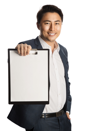 well laid: Attractive businessman in a blue suit and white shirt, holding a clipboard and a pen. Standing against a white background with a big toothy smile.