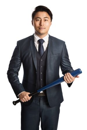 Frustrated businessman in a blue suit and tie standing against a white background holding a baseball bat. 版權商用圖片