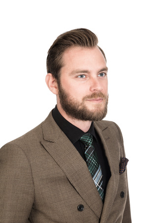 careless: Handsome tough bearded businesman in a brown suit, black shirt and tie. Standing against a white background smiling. Stock Photo