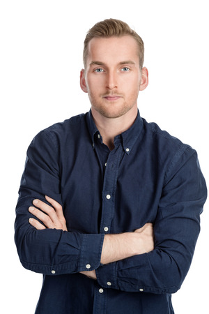 Handsome blonde man wearing a blue shirt standing against a white background looking at camera. Stock Photo