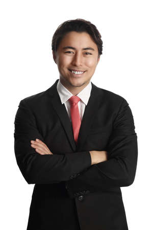 Picture of a successful Asian male entrepreneur smiling at the camera wearing a red tie black coat and white collared shirt. Standing against a white background.