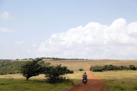 maharashtra: A lone biker on Kaas Plateau in Maharashtra, India
