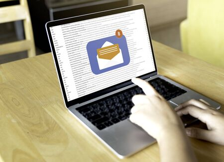 Person using a laptop computer with email communication connection message online and chat on social media with global letters concept. Laptop mockup
